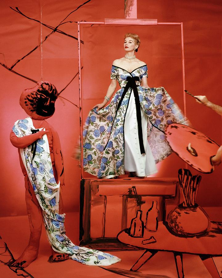A Portrait Of Lisa Fonnsagrives On A Red Set Photograph by Horst P. Horst