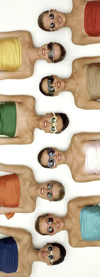 A Row Of Models In Strapless Tops And Sunglasses Photograph by Richard Rutledge