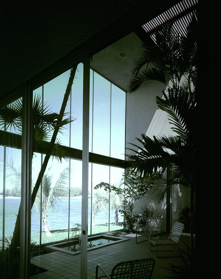 A Screened Patio Photograph by Robert M. Damora