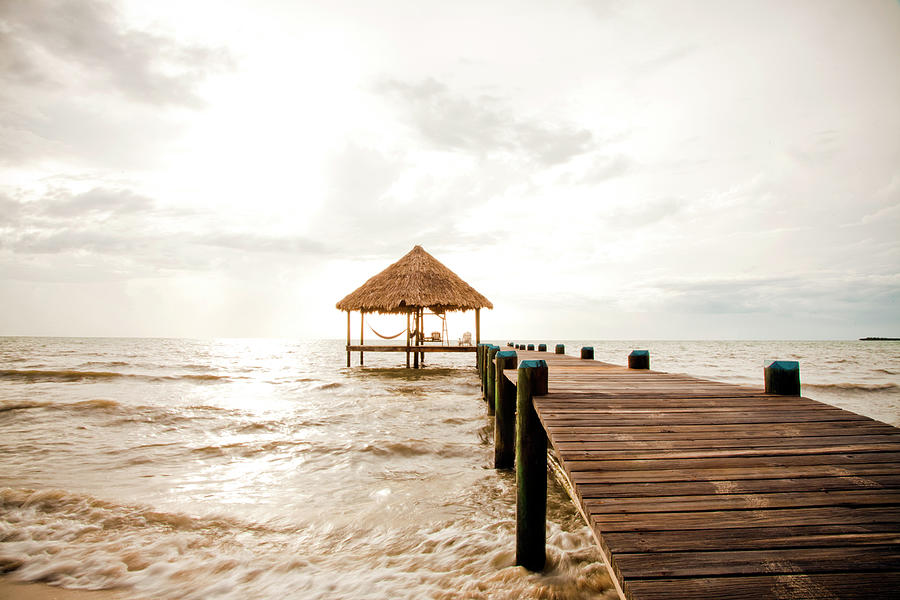 A Serene Dock And Cabana At Sunrise Photograph by Adam Hester