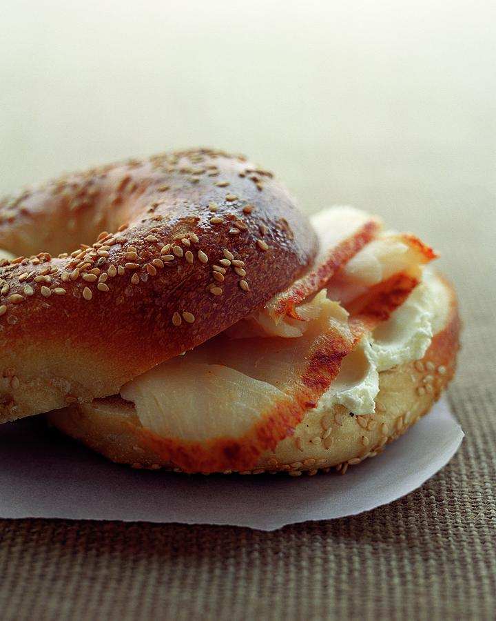 A Sesame Bagel Photograph by Romulo Yanes
