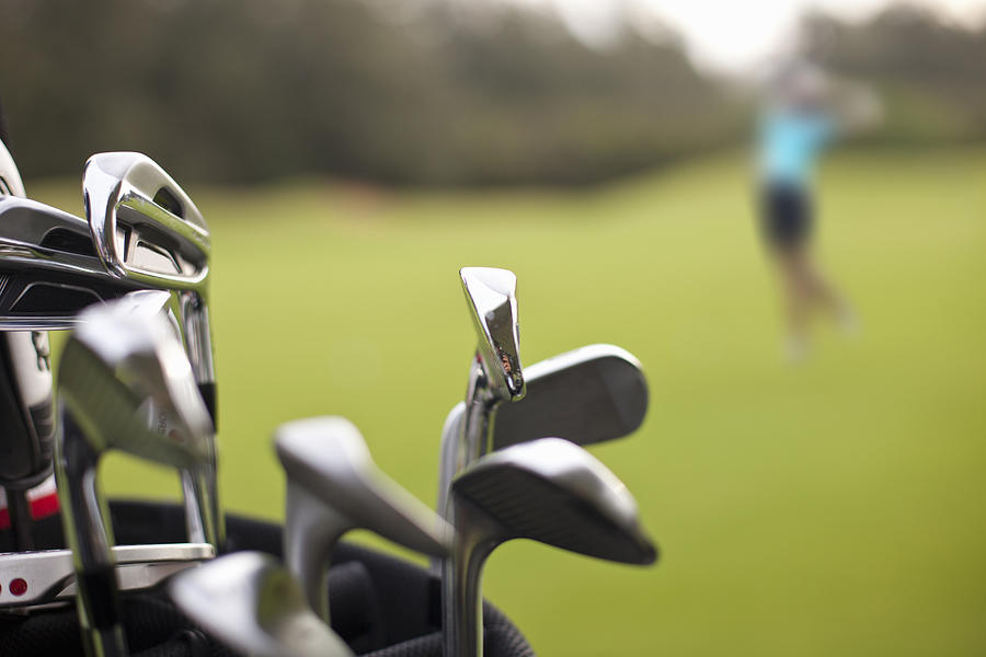 A set of golf clubs on the green Photograph by Noel Hendrickson