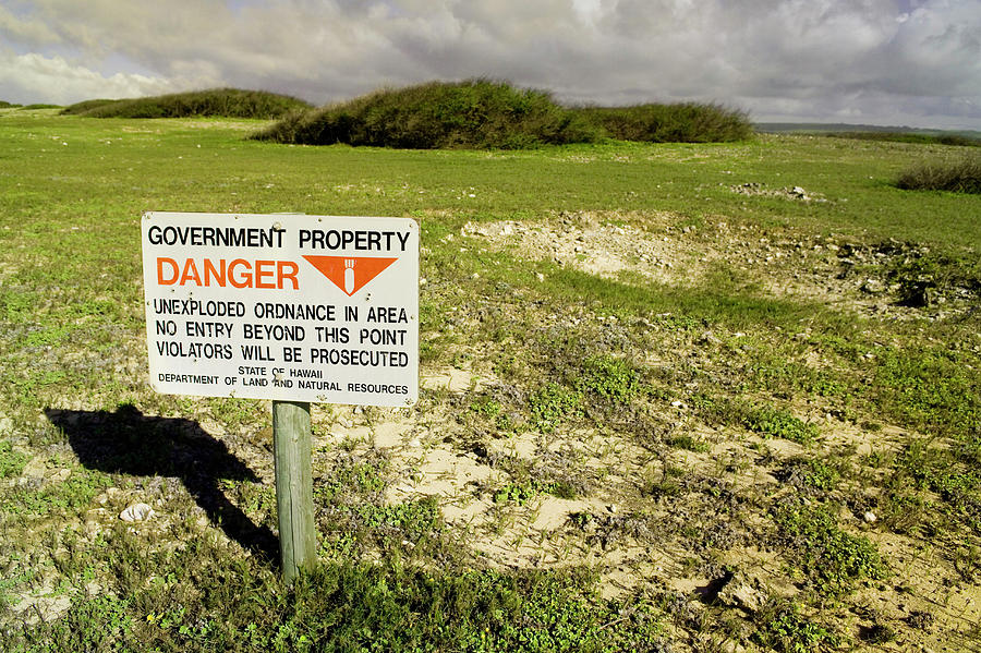 Aftermath Photograph - A Sign Warns Of Dangerous Unexploded by Jonathan Kingston