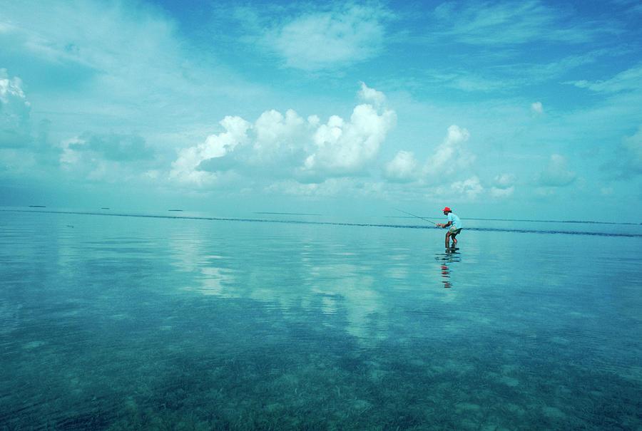 Alone Photograph - A Single Fisherman Bone Fishing by Jose Azel