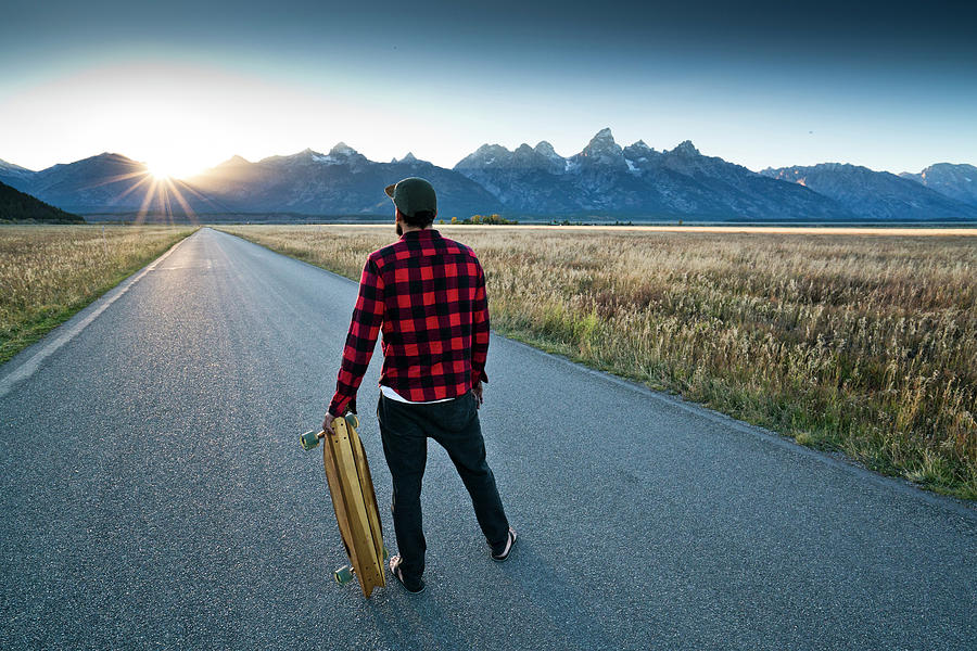 Adult Photograph - A Skateboarder Watching The Sun Set by Rob Hammer