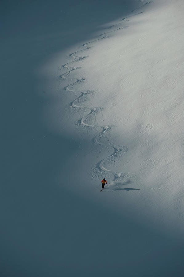 Breaking New Ground Photograph - A Ski Guide Dances With A Mountain by Topher Donahue