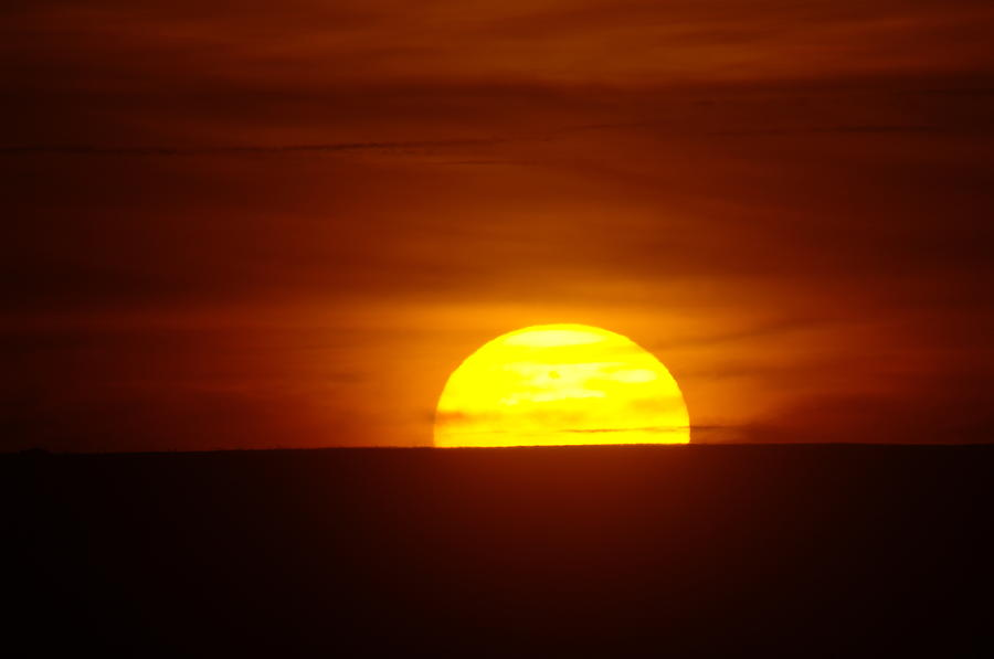 Sun Photograph - A Slow Sunset by Jeff Swan