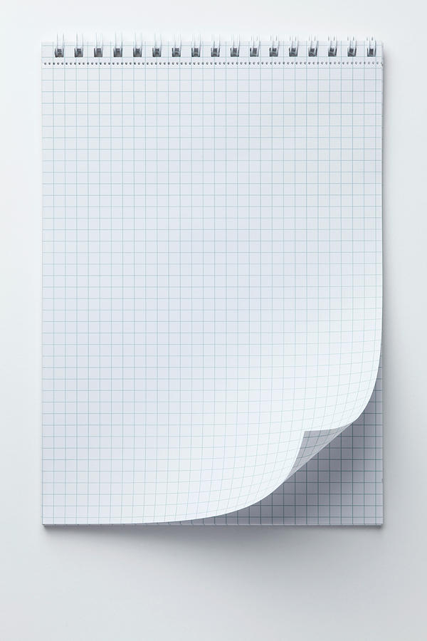 a spiral notepad with graph paper and a by caspar benson