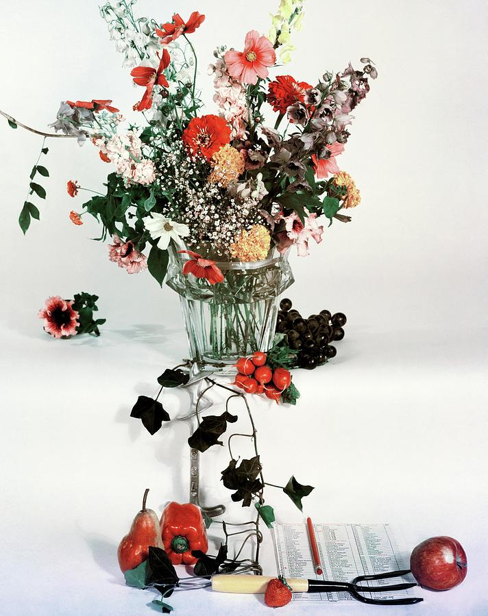 A Studio Shot Of A Vase Of Flowers And A Garden Photograph by Herbert Matter