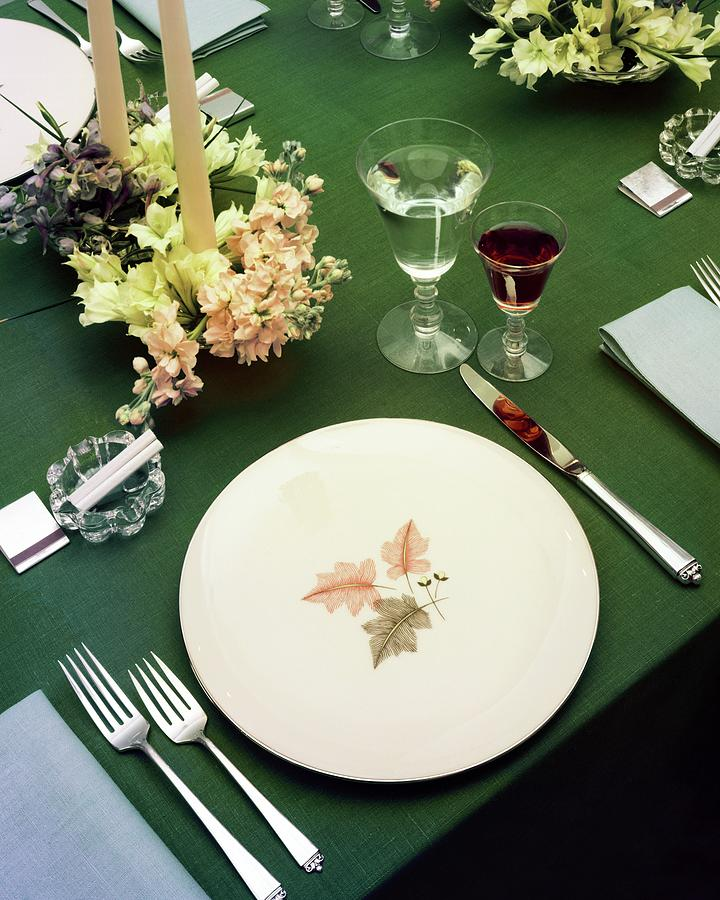 A Table Setting On A Green Tablecloth Photograph by Haanel Cassidy