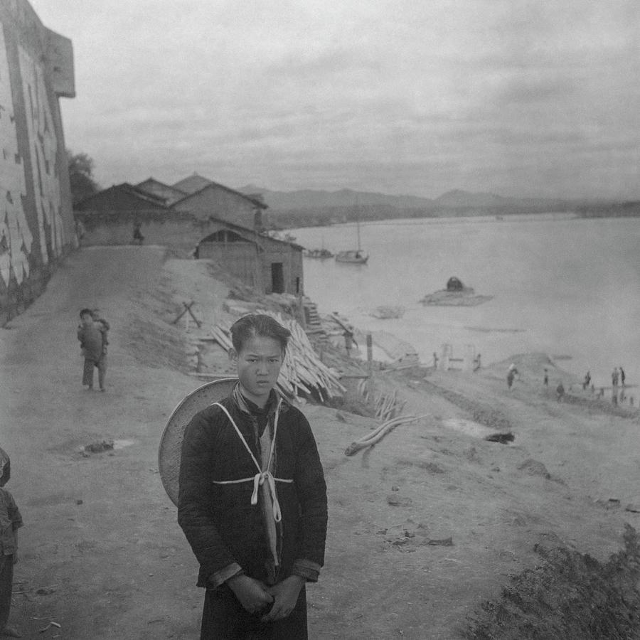A Teenage Boy By Min River In Sichuan Photograph by Cecil Beaton