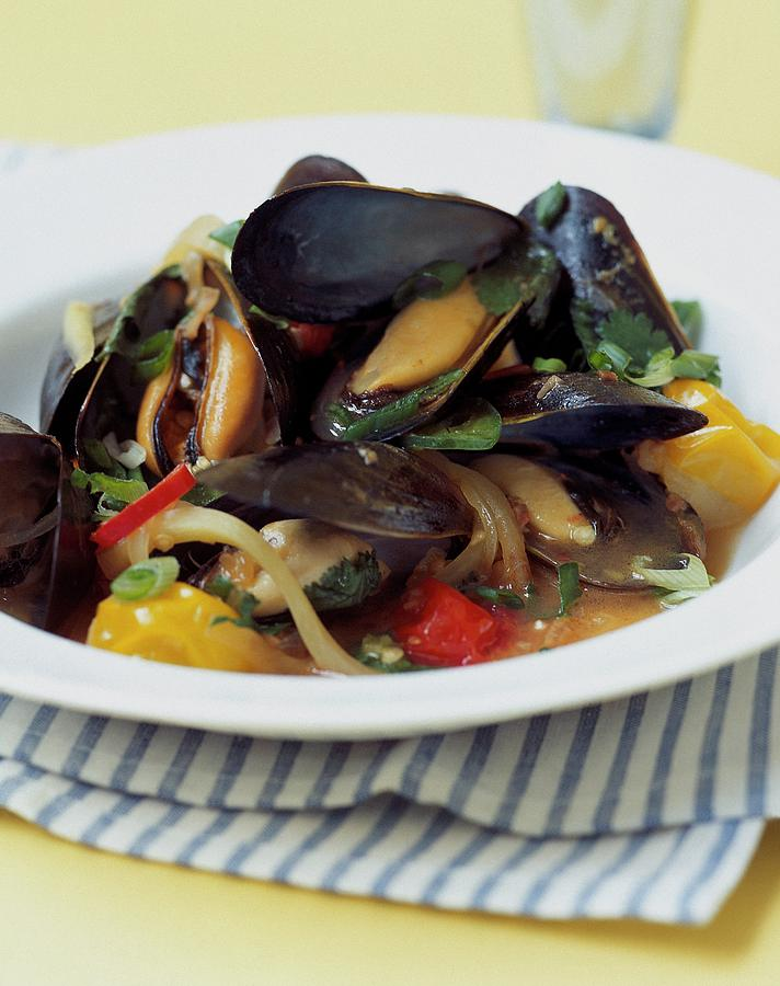 A Thai Dish Of Mussels And Papaya Photograph by Romulo Yanes