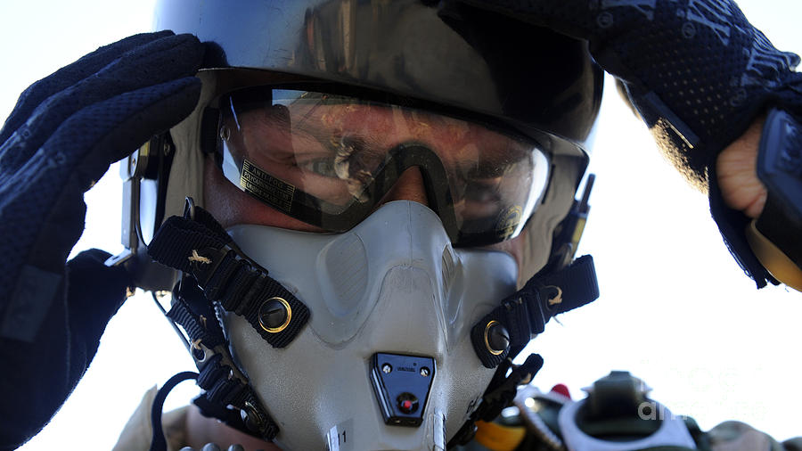 A U.s. Airman Secures His Oxygen Mask Photograph