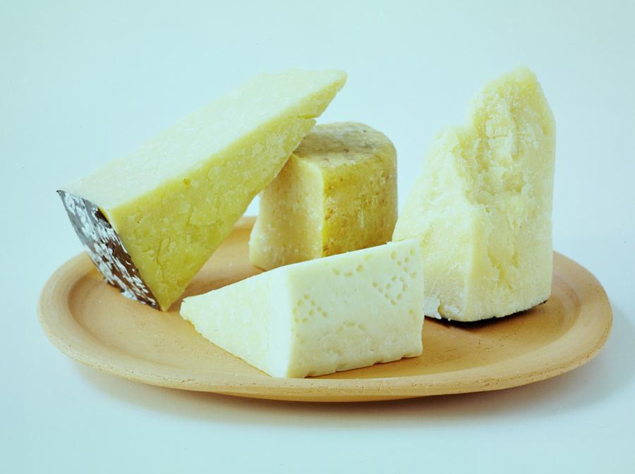 A Variety Of Cheese On A Plate Photograph by Romulo Yanes