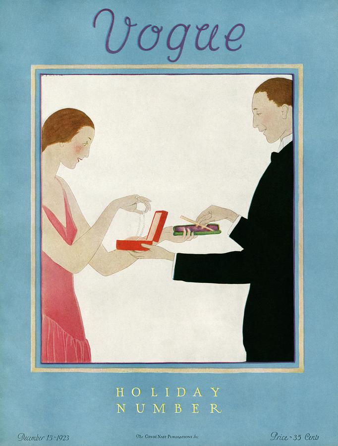 A Vogue Cover Of A Couple Exchanging Gifts Photograph by Andre E.  Marty