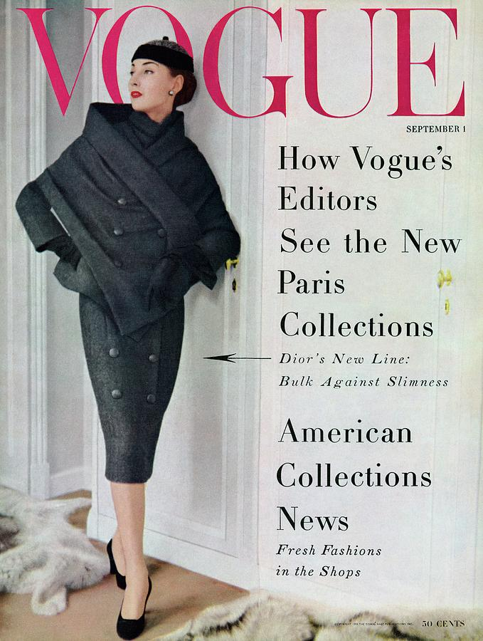 A Vogue Cover Of A Model Wearing A Dior Suit Photograph by Henry Clarke