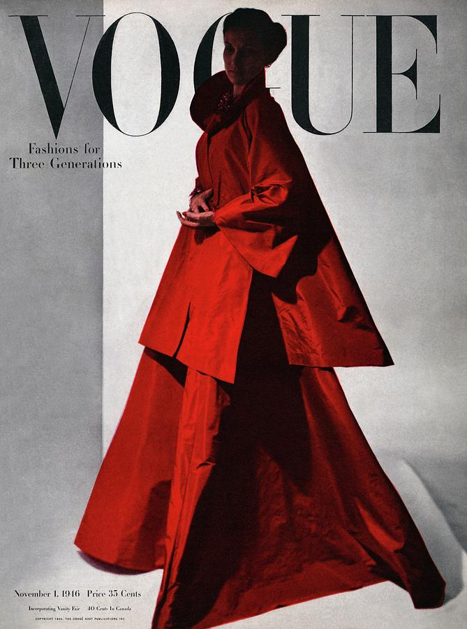 A Vogue Cover Of A Woman Wearing A Red Photograph by Horst P. Horst