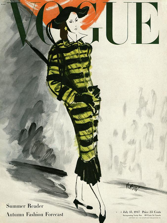 A Vogue Cover Of A Woman Wearing A Striped Coat Photograph by Rene Bouet-Willaumez
