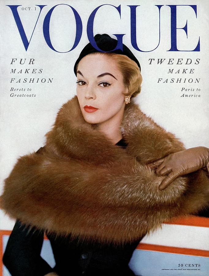 A Vogue Cover Of Jean Patchett Wearing A Fur Wrap Photograph by Horst P. Horst