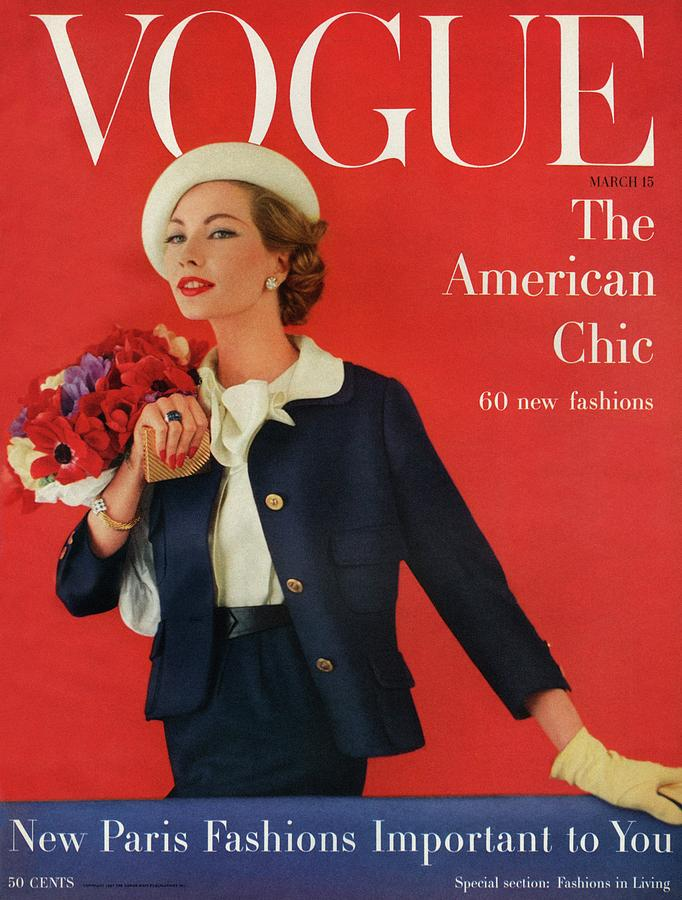 Fashion Photograph - A Vogue Cover Of Jessica Ford With Flowers by Karen Radkai
