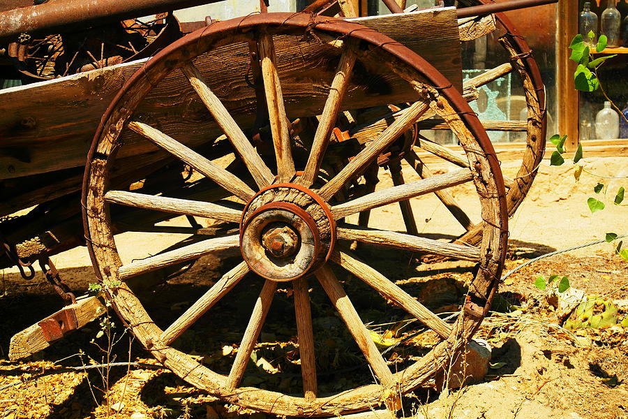 Rounds Photograph - A Wagon Wheel by Jeff Swan