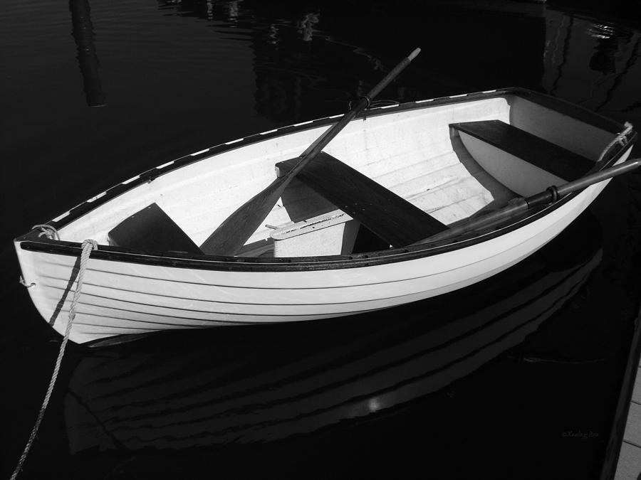 Boats Photograph - A White Rowboat by Xueling Zou