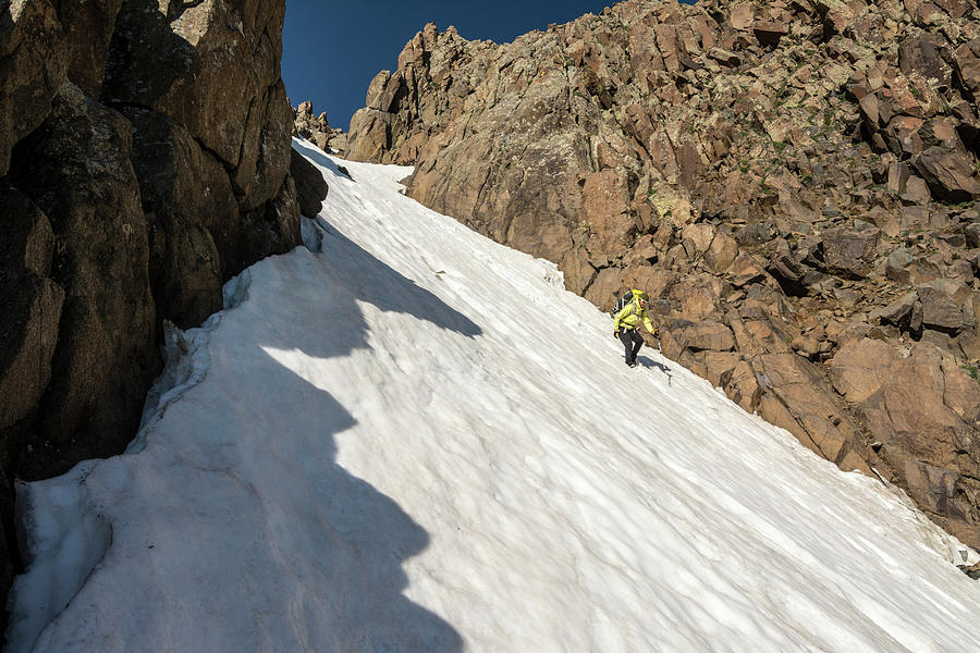 Landscape Photograph - A Woman Descending A Snow Slope While by Kennan Harvey