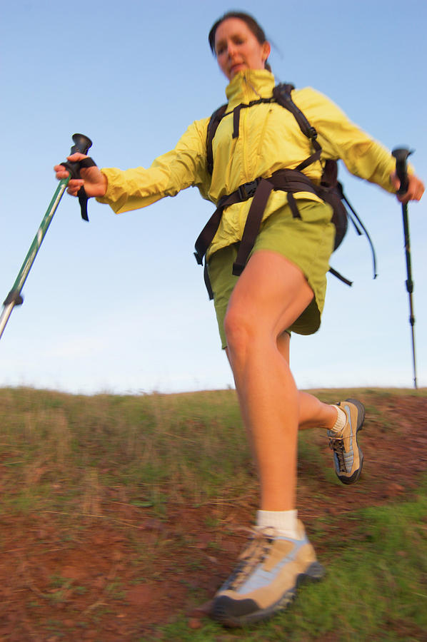 Adult Photograph - A Woman Hiking In Green Hills by Ty Milford