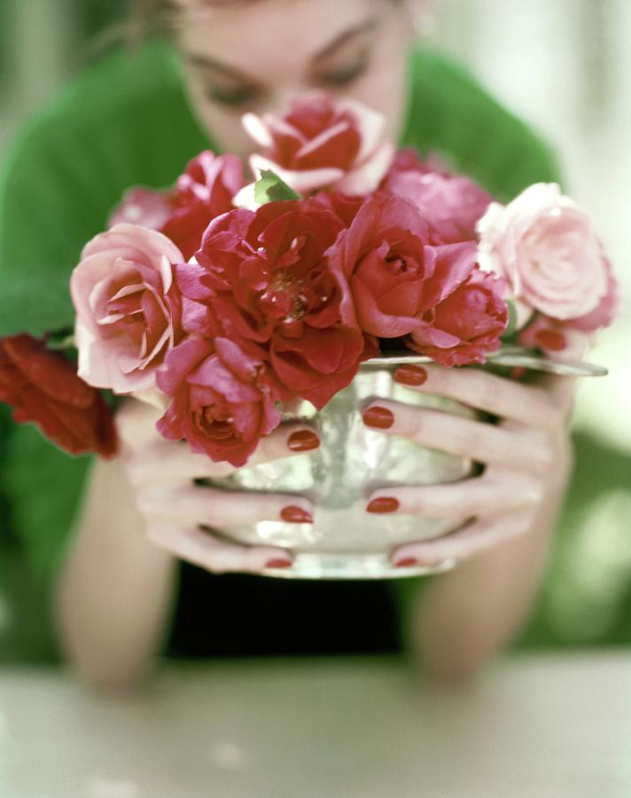 A Woman Holding A Bowl Of Roses Photograph by John Rawlings