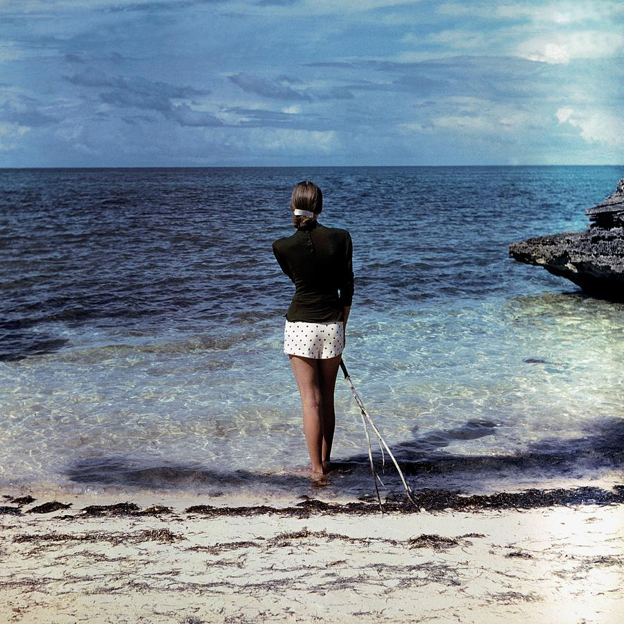 A Woman On A Beach Photograph by Serge Balkin