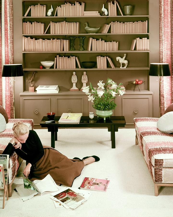 A Woman Reading Magazines On The Floor Photograph by Haanel Cassidy