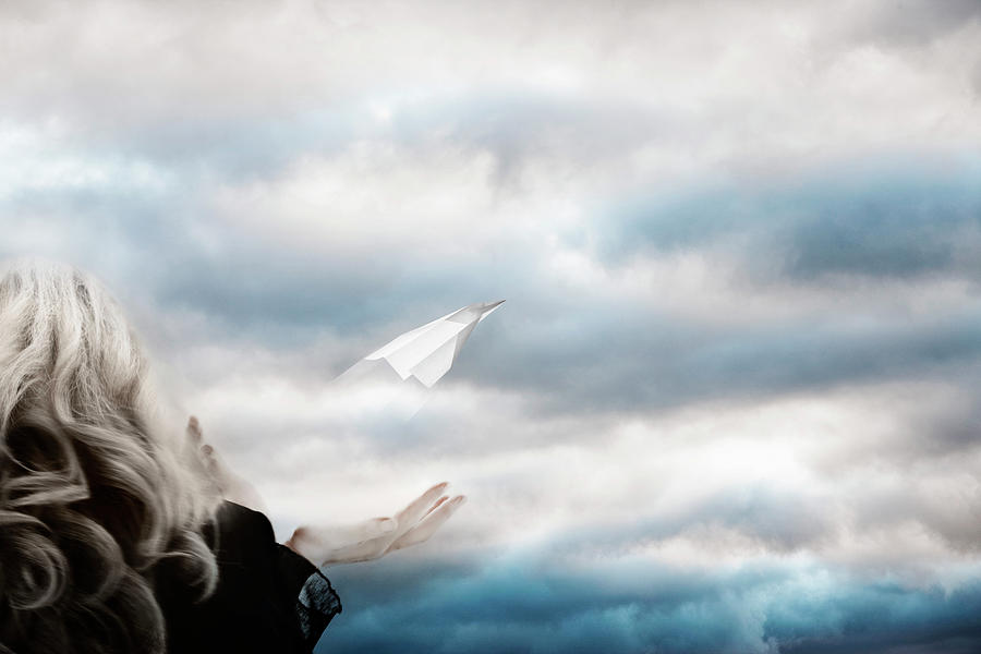 A Woman Releasing A Paper Plane Into Photograph by Andrew Bret Wallis