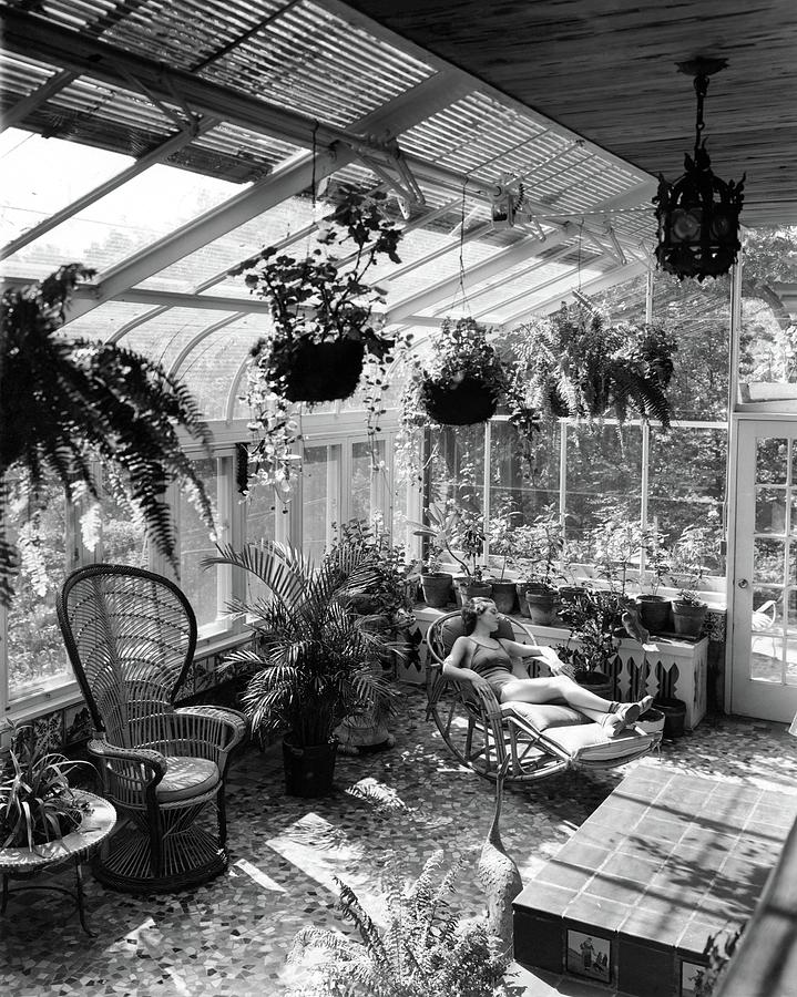 A Woman Resting On A Chair Inside A Greenhouse Photograph by Eric J. Baker