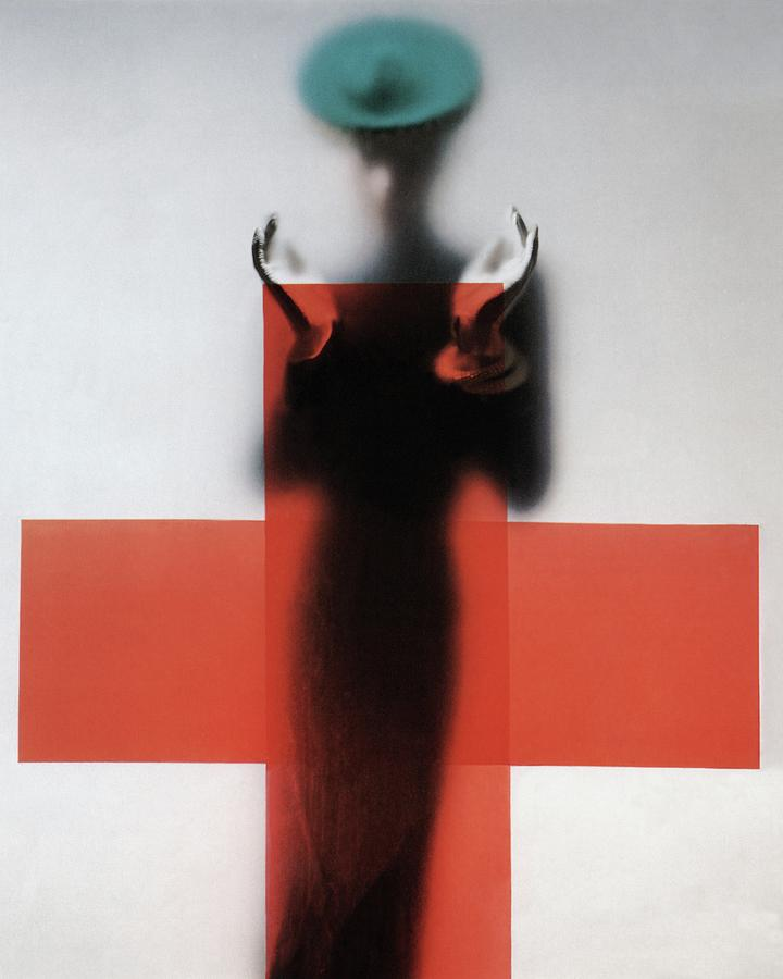 A Woman Standing Behind A Red Cross On Frosted Photograph by Erwin Blumenfeld