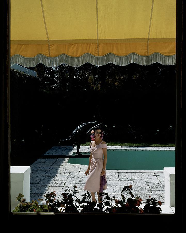 A Woman Walking Beside Her Swimming Pool Photograph by John Rawlings
