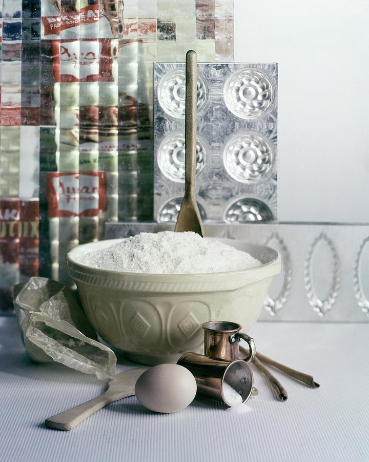 A Wooden Spoon In A Bowl Of Flour Photograph by Richard Jeffery