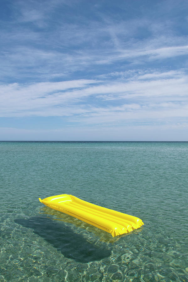 A Yellow Inflatable Raft Floating On Photograph by Caspar Benson