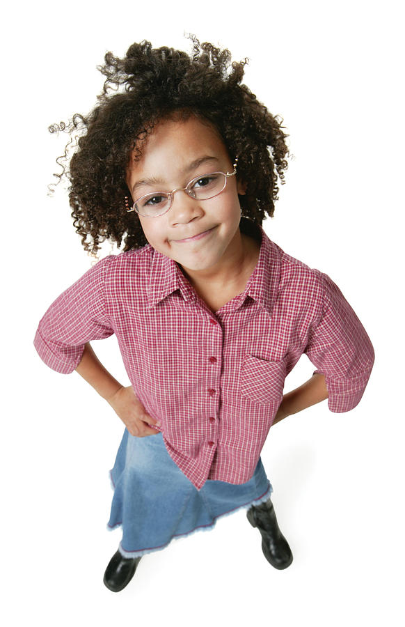 A Young African American Girl In A Jeans Skirt And A Red Shirt Puts Her Hands On Her Hips And Smiles Up At The Camera Photograph by Photodisc