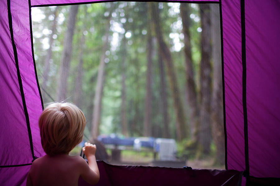 Boy Photograph - A Young Boy Looks Out Of A Tent by Jan Sonnenmair