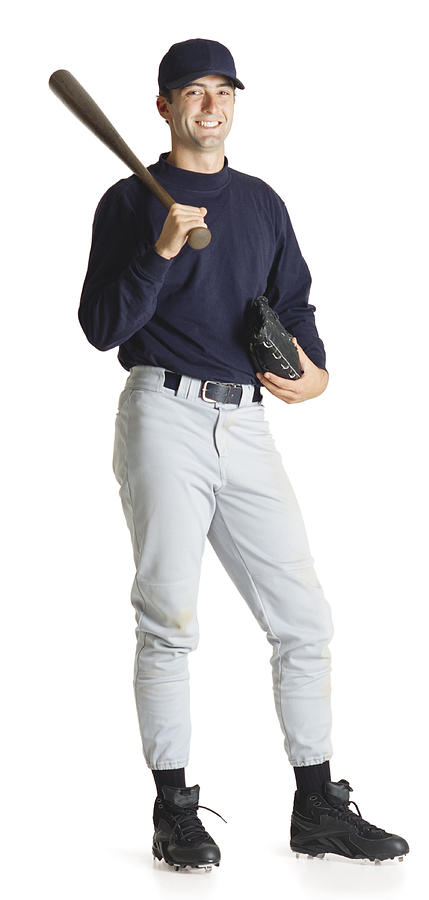 A Young Caucasian Male Baseball Player In A Blue Shirt And Hat Holds His Bat Over His Shoulder And Smiles Photograph by Photodisc