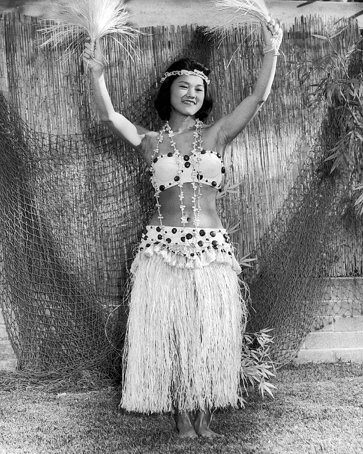 1940s Photograph - A Young Hawaiian Hula Woman by Underwood Archives