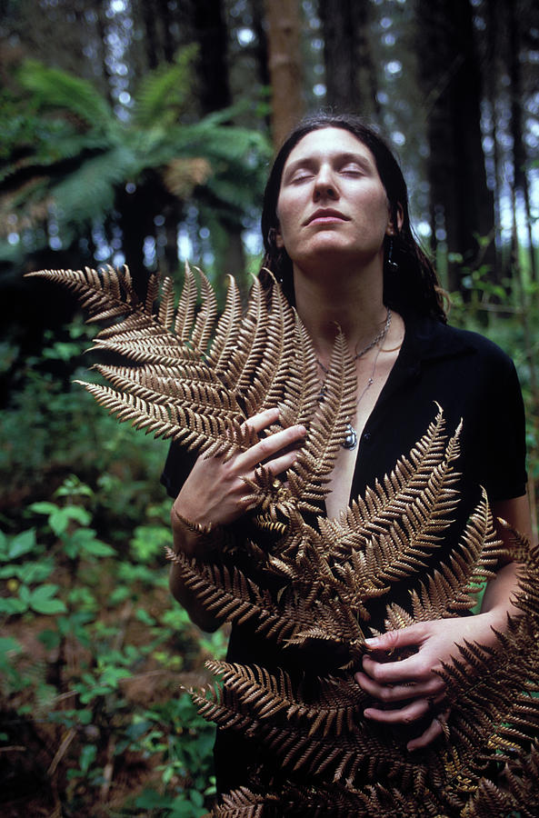 Calm Photograph - A Young Woman Cradles A Fern Frond by Kyle George