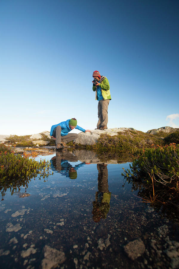 Alpine Photograph - A Young Woman Explores The Microclimate by Christopher Kimmel
