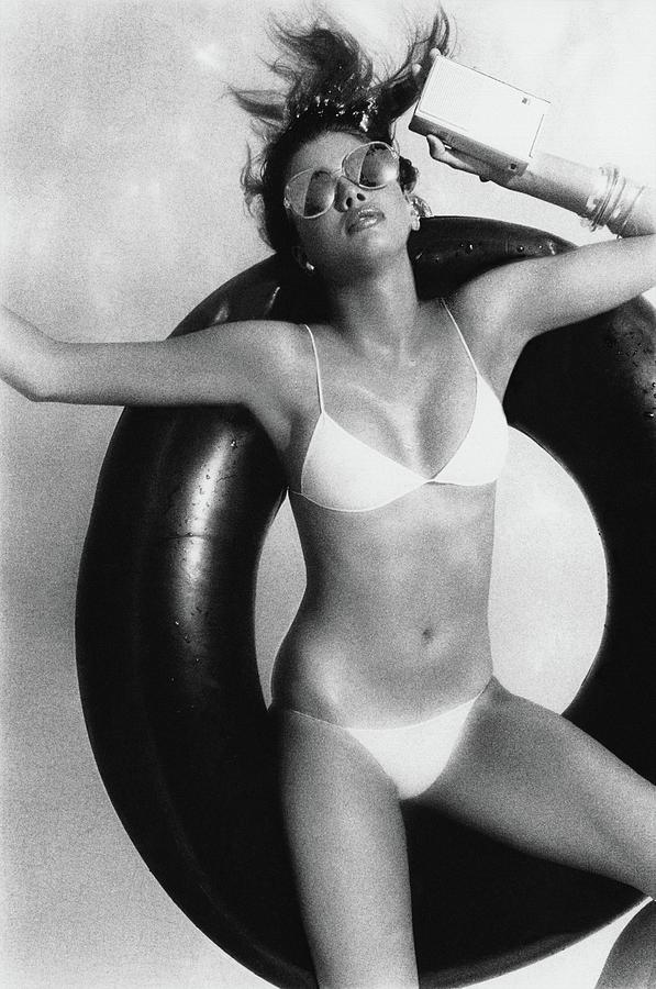 Debbie Dickinson Floating On An Inner Tube Photograph by Albert Watson