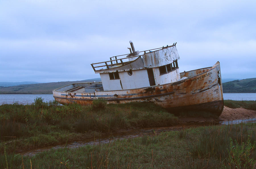 Abandoned Boat Photograph by Bernard Barcos