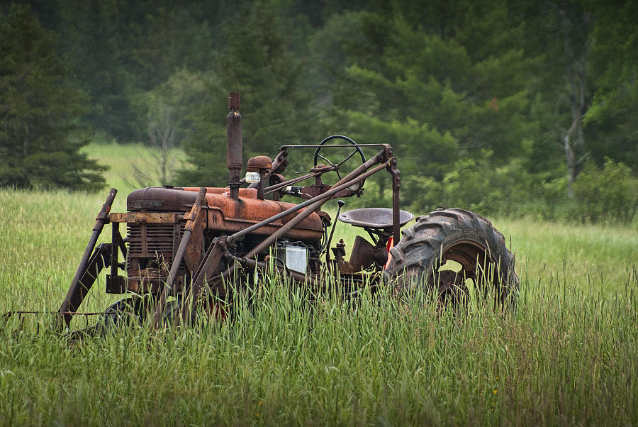 Tractor Photograph - Abandoned Farm Tractor In The Grass by Randall Nyhof