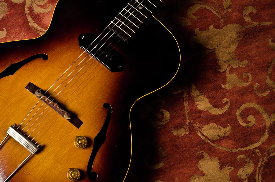 Acoustic Guitar On Red Background Photograph by Bns124