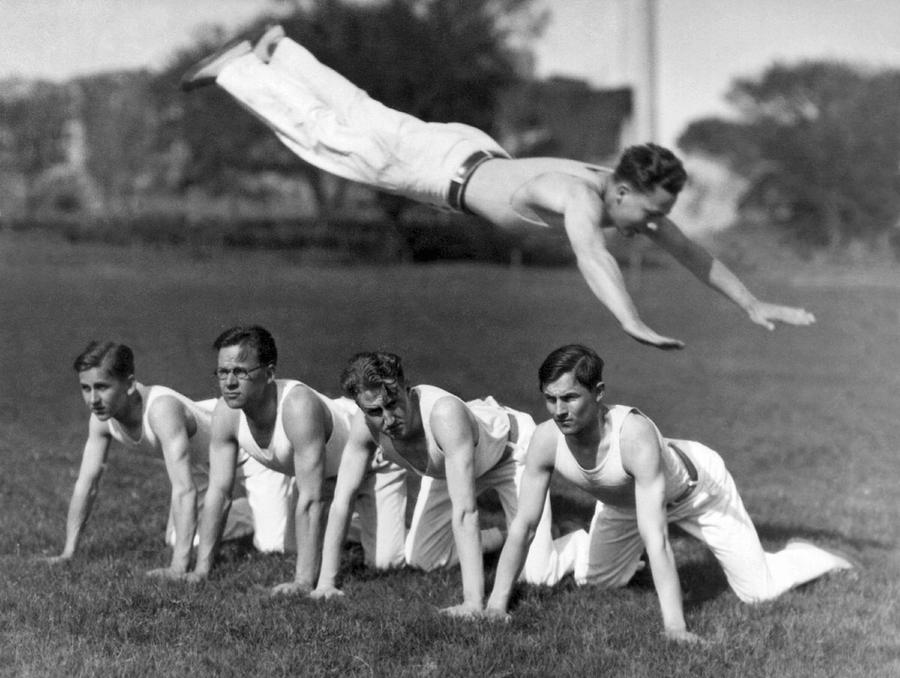 1926 Photograph - Acrobatic Swandive by Underwood Archives