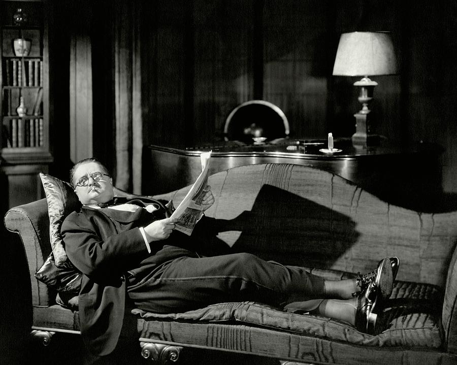 Actor Alexander Woollcott On A Couch Photograph by Nick Lazarnick