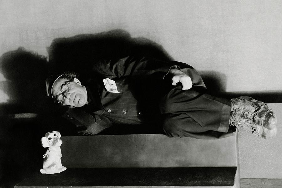 Actor Ed Wynn Lying Down On A Bench In the Laugh Photograph by Florence Vandamm